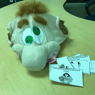 Photo of silly looking Ed's head and cards with examples of distractions students encounter